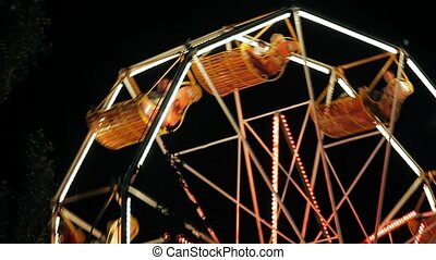 The old carousel in a small provincial park at night - In...
