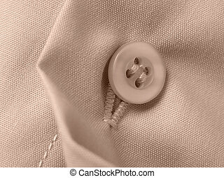 shirt fragment - sepia toned shirt fragment with button...