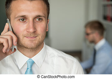 Young Businessman Talking On The Phone - Happy Young...
