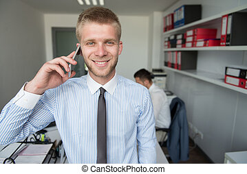 Young Businessman On The Phone - Happy Young Business Man...