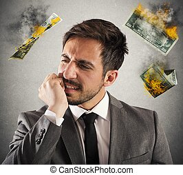 Business in smoke - Angry businessman with money which are...