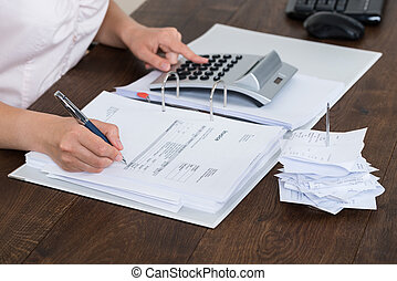 Accountant Calculating Receipt - Close-up Of Accountant...