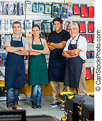 Salespeople Smiling In Hardware Store - Portrait of...