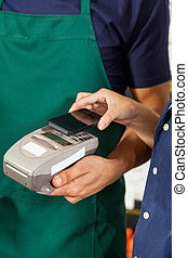 Customer Paying With Mobilephone Using NFC Technology -...