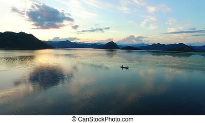 fishing boat on beauty, big Skadar lake in south of...