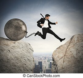 Businessman overcomes obstacles - Businessman jumping with...