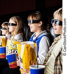 Siblings Watching 3D Movie In Cinema Theater