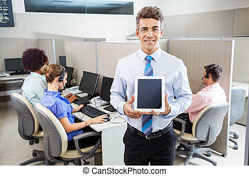 Smiling Manager Holding Tablet Computer At Call Center -...