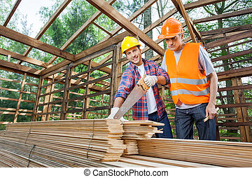Male Construction Workers Working At Site