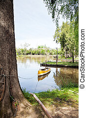Canoe Moored In Lake - Empty canoe moored in lake against...