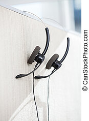 Headphones Hanging On Cubicle Partition - Headphones hanging...