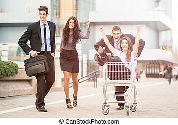 Consumer Rush - Group of young business people on the street...