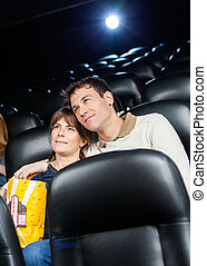 Affectionate Couple Watching Film In Theater