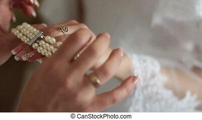 bride wears bracelet on hand