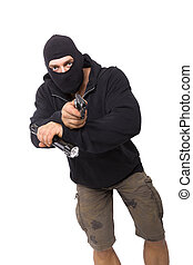 Robber. - Man in black mask and black cloth holding...