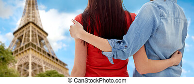 close up of happy lesbian couple over eiffel tower - people,...