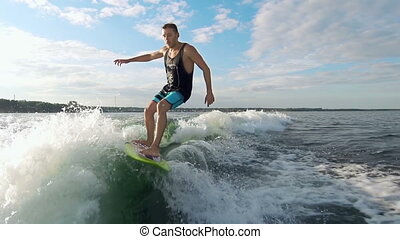 Lord of the Waves - Slow motion of wakesurfer riding the...