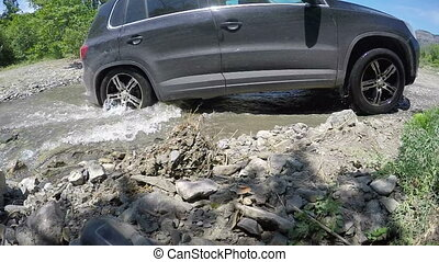 Cars crossing mountain creek slow motion