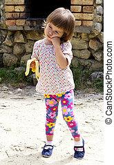 Girl eating a banana - Crying girl eating a banana
