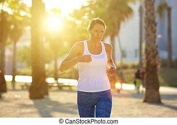 Woman running outdoors in summer