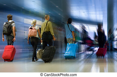Airline Passengers - Airline passengers walking in the...