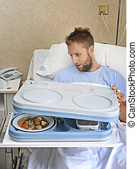 patient man in hospital room after suffering accident opening meal tray ready to have a healthy diet clinic lunch