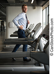 Businessman Exercising In Gym