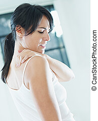 nechache - woman massaging neck Side view, copy space