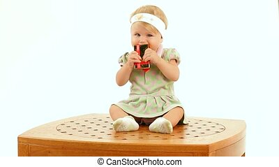 Child Plays With A Gift - Funny little girl sitting on the...