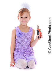 Little girl holding a pair of pliers - Funny little girl...