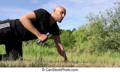 Man Training in Nature On Grass