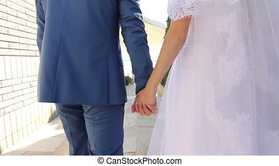 newlyweds walk ing and handing in the park slow motion -...