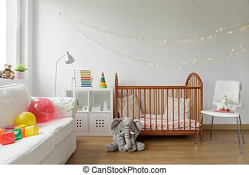 Newborn room interior - Photo of white and cosy newborn room...