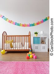 Babygirl bedroom with wooden crib - Photo of babygirl...