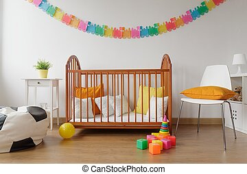 Newborn bedroom with wooden crib - Image of newborn bright...