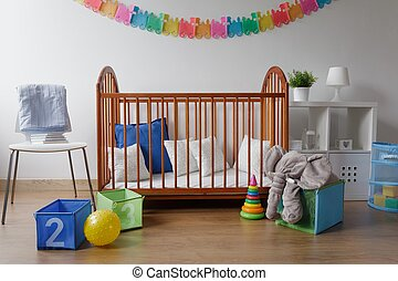Toys in modern baby bedroom - Photo of colorful toys in...