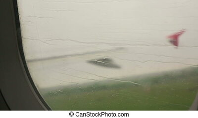 Airplane takes off in heavy rain