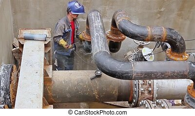 Welding junction. - Welder is welding pipe junction...