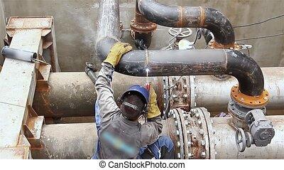 Welding junction. - Welder is welding pipe junction...