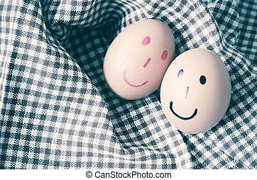 smile egg - smile love egg couple in brown kitchen towel on...