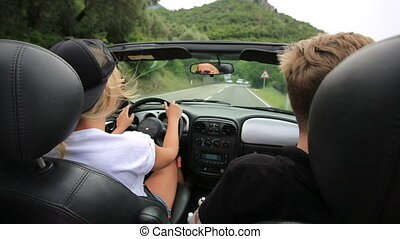 Couple in convertible car, motenegro