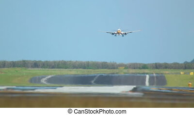 Airplane landing - The aircraft touch the runway. Mist hot...