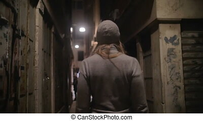 Woman Walking Along the Narrow Street - Steadicam slow...