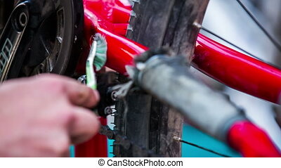 Human Hand Cleaning Frame Of Bicycle With Toothbrush -...