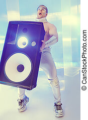 innovation - Futuristic muscular man dancing with huge music...