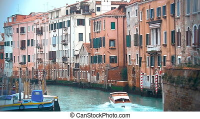 Motor Boat Sailing along the Water Canal in Venice, Italy.