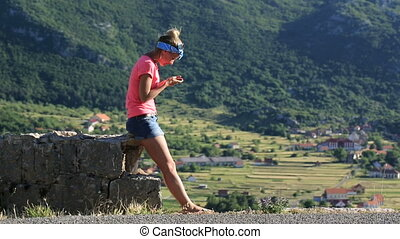 woman taking photo with mobile cell phone, Montenegro