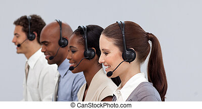 Multi-ethnic young business partners working in a call center