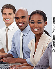 Diverse confident business team sitting in a row smiling at...