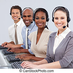 Multi-ethnic business people with headset on in a call center
